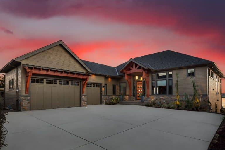 Beautiful Luxury Home Exterior at Sunset with Colorful Sky, How To Fill The Gap Between Driveway And Garage