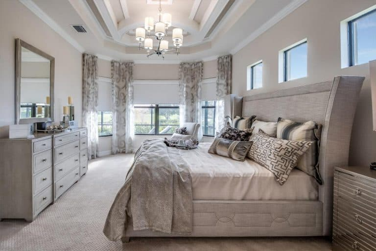 Beautiful master bedroom with gray furniture, Should The Master Bedroom Be Upstairs Or Downstairs?