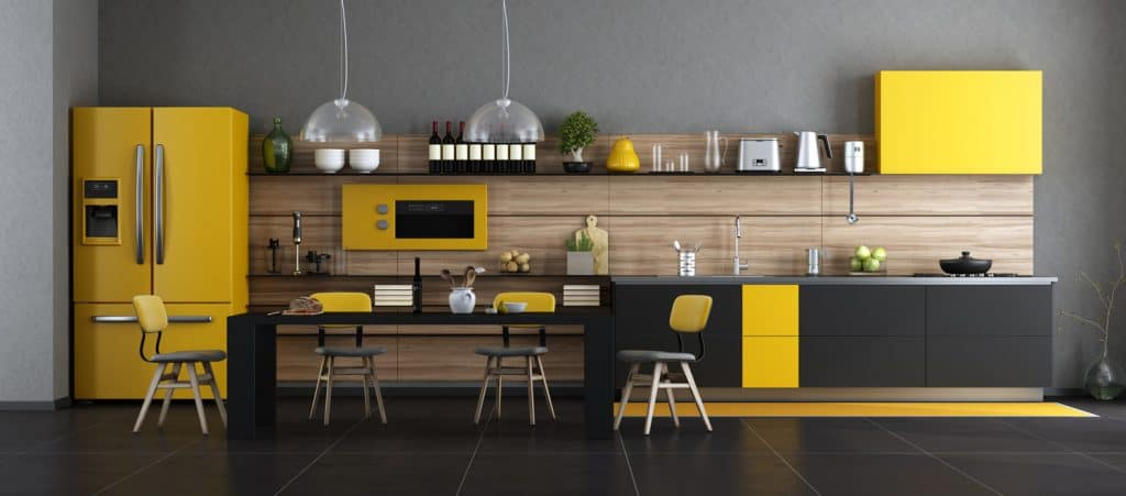 Black and yellow modern kitchen with dining table and chairs