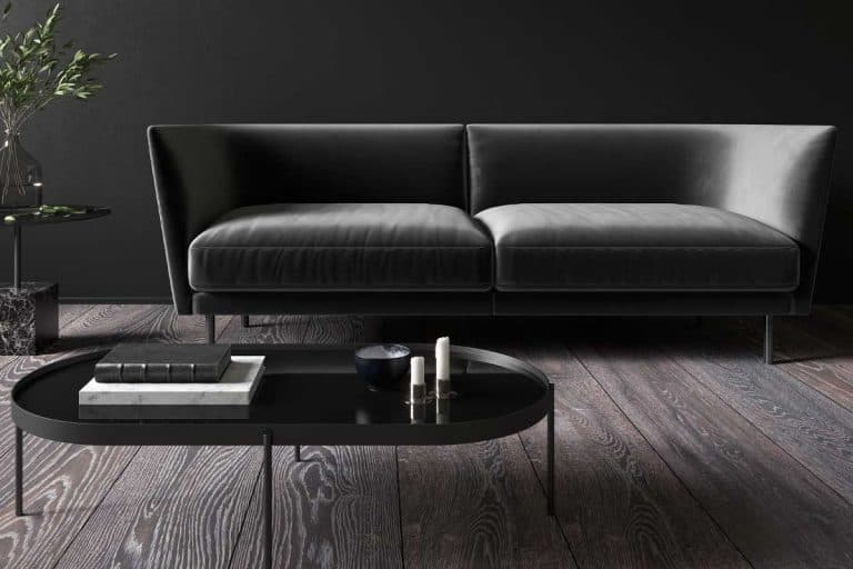 A black minimalistic interior with couch and coffee table, What Color Coffee Table Goes With A Black Couch?