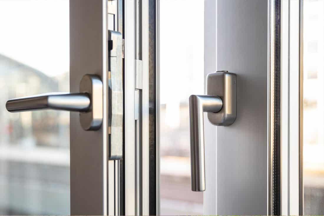 Close up view of aluminum door and handles, How To Paint An Aluminum Door In 6 Easy Steps