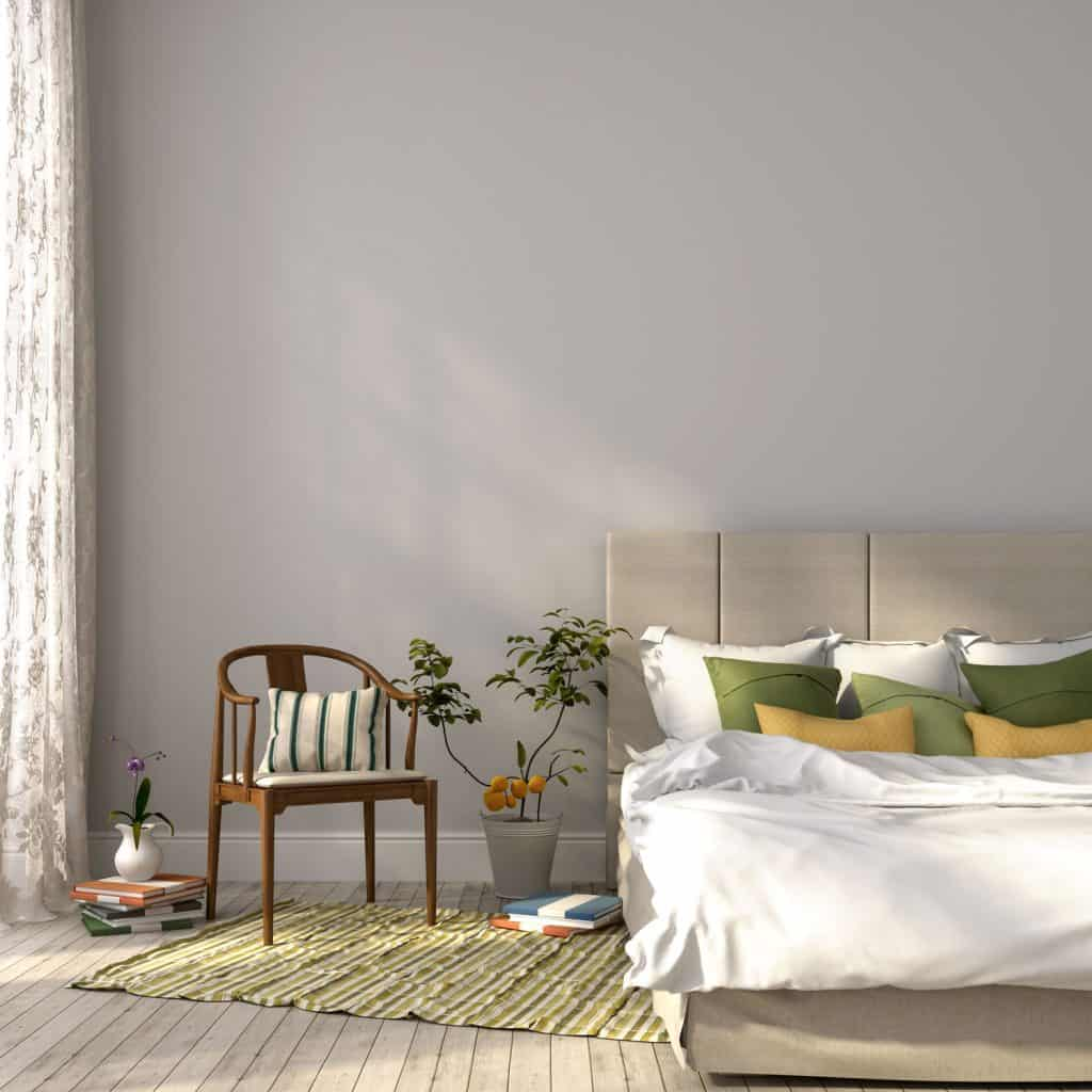 Elegant bedroom with gray painted walls, plants and elegant beddings