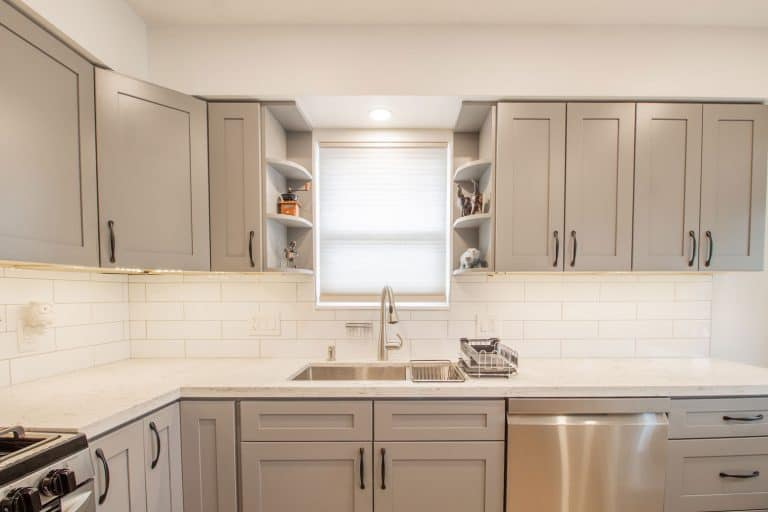 Gray cabinets and cupboard inside a small and narrow kitchen, What Color Walls Go With Gray Kitchen Cabinets?