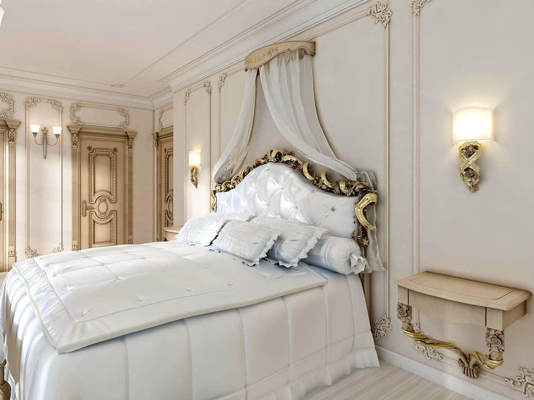 Great classic four-poster bed and soft white comforter