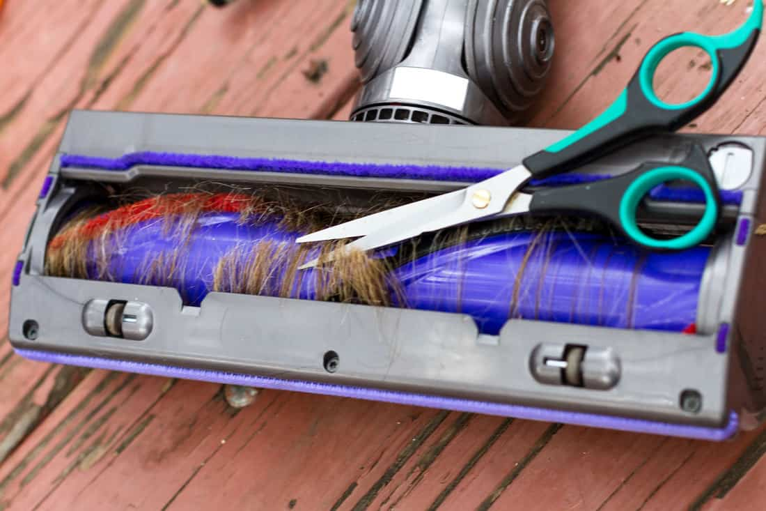 Hair and other dirt gathering inside a vacuum cleaner