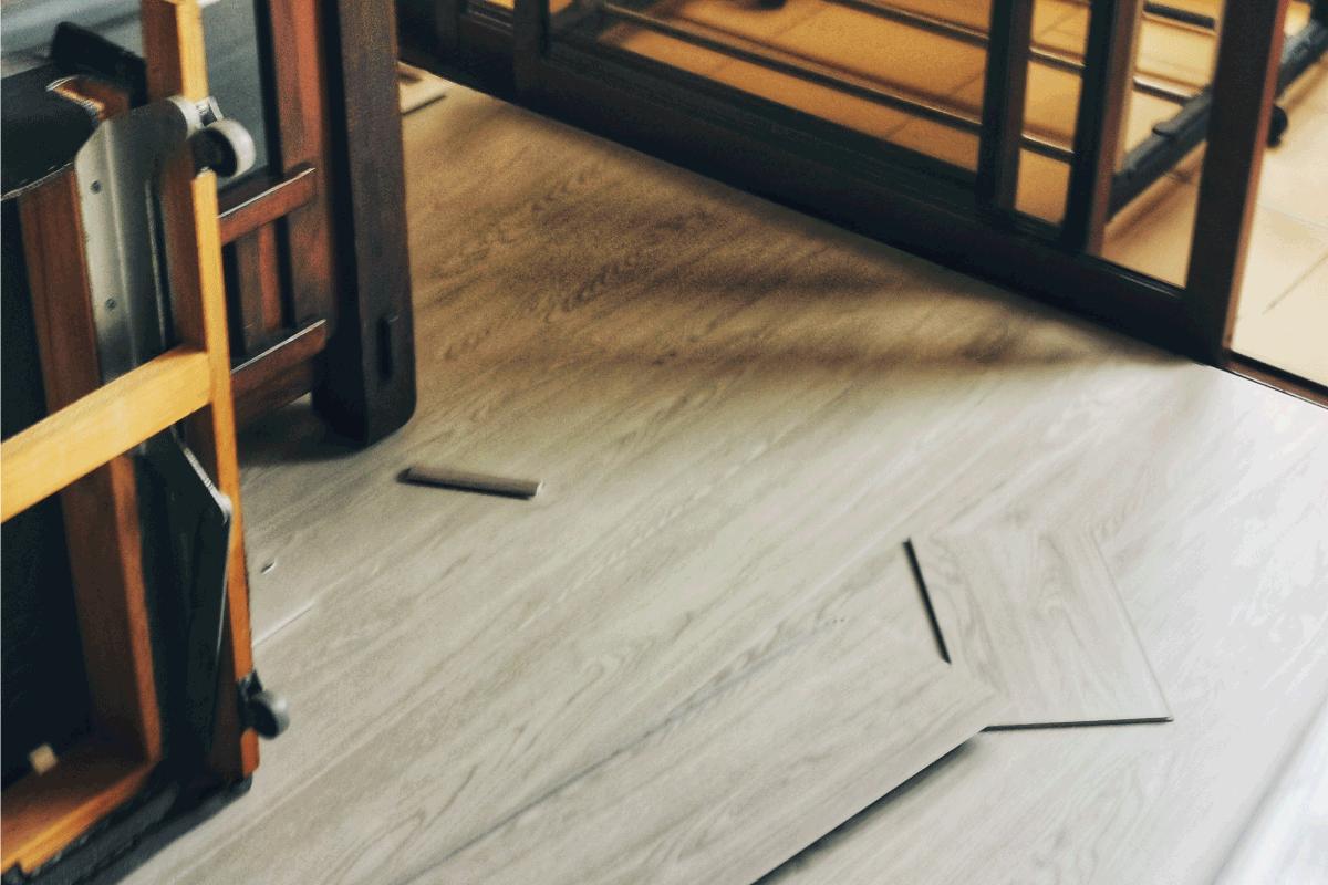 Home improvement on flooring work adding vinyl floor in living room. How To Fix Cracks In Vinyl Plank Flooring