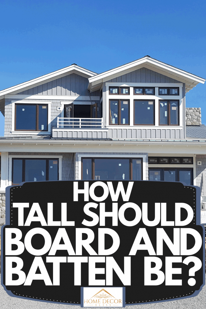 A house under construction with board and batten siding and huge windows, How Tall Should Board And Batten Be?