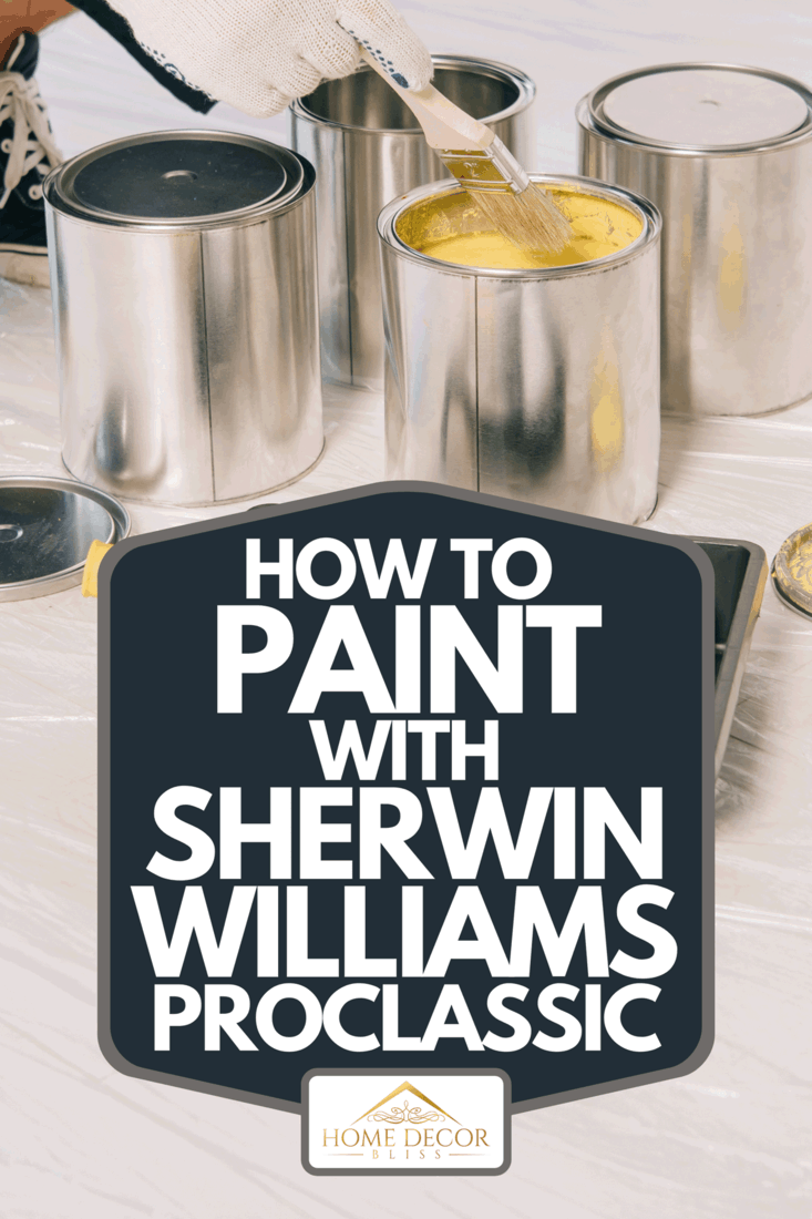 View of painter taking yellow paint from can with paintbrush, How To Paint With Sherwin Williams ProClassic