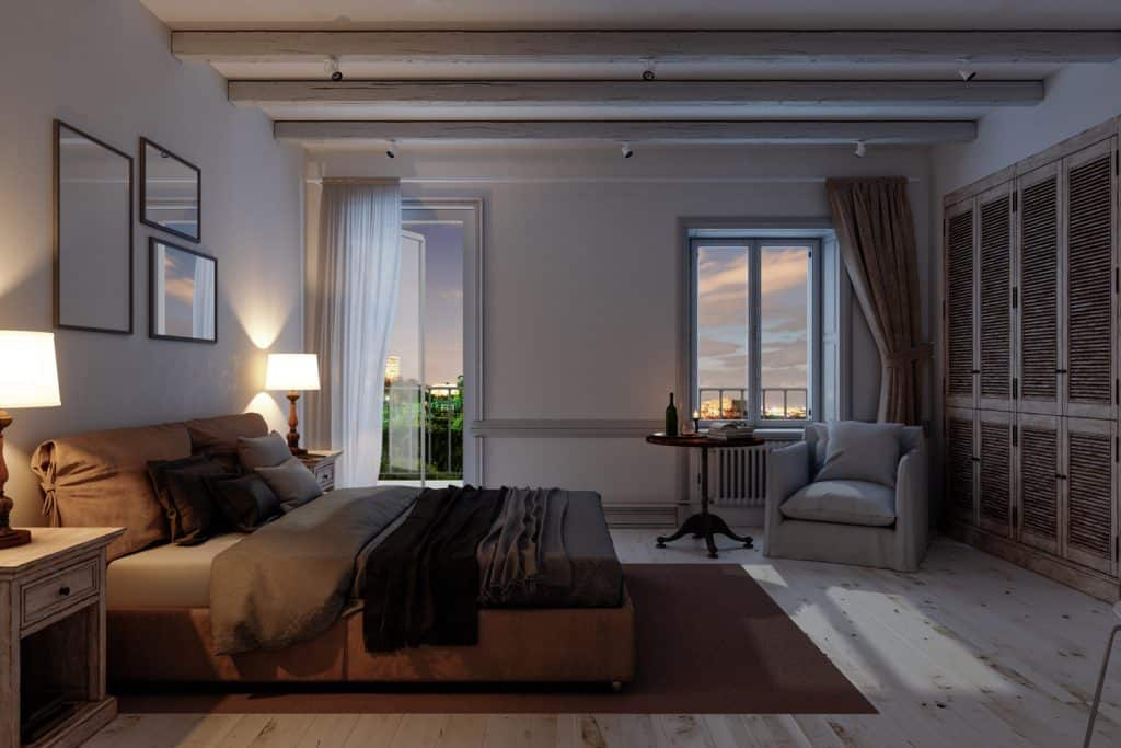 Interior of a classic Scandinavian bedroom at night.