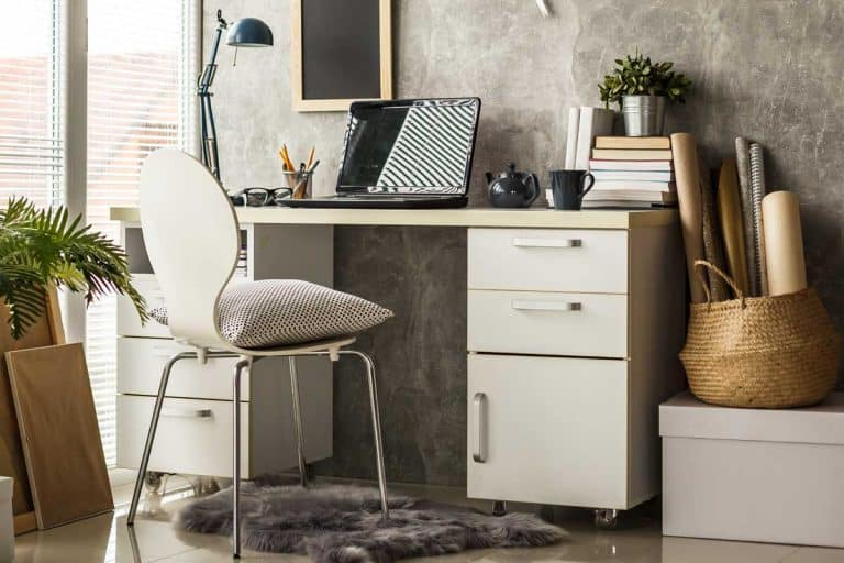Interior of a modern home office with laptop on desk, How To Paint An Ikea Desk [10 Simple Steps]