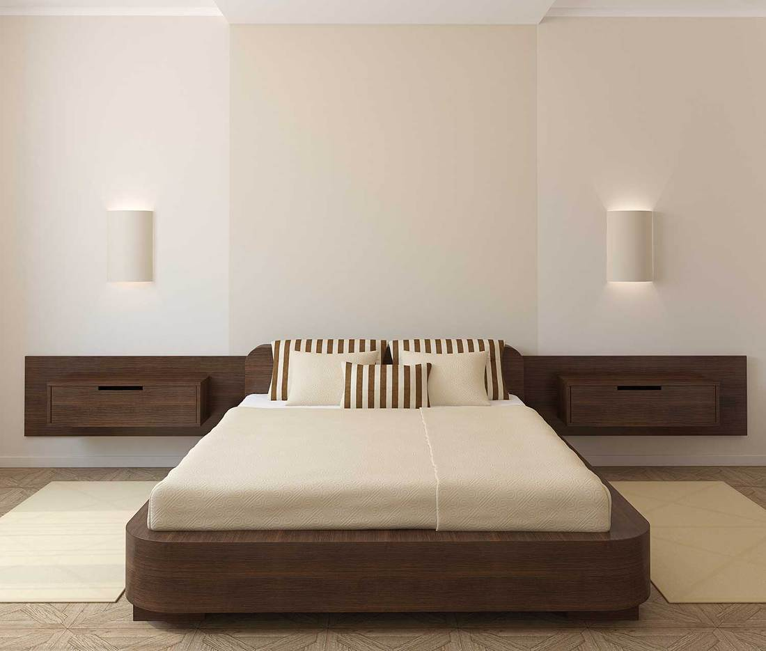 Interior of modern bedroom with bedside sconces