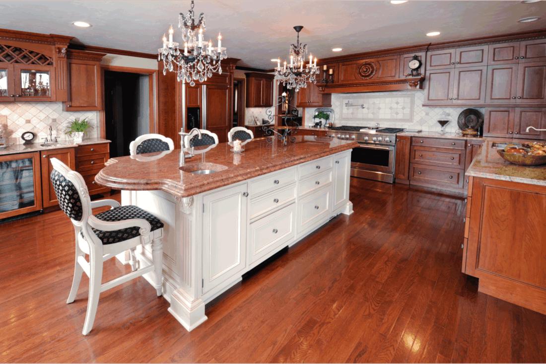 Kitchen, Dark Hardwood Floors, Cabinets, Chandelier, Marble Granite Counters