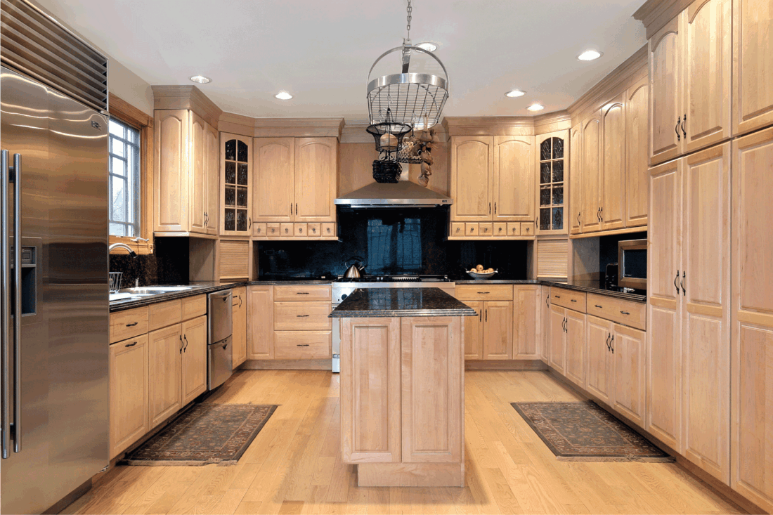 Kitchen in new construction home with wooden floor and wooden cabinets