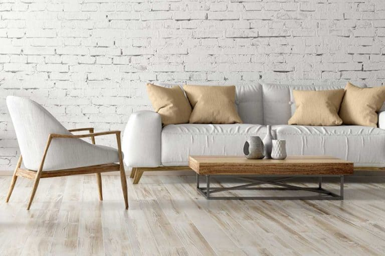 A modern interior of living room with white couch, coffee table and accent chair, What Accent Chairs Go With A White Couch?
