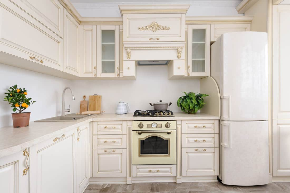 Modern spacioius beige colored luxury kitchen, clean design, What Color Walls Go With Cream Cabinets?