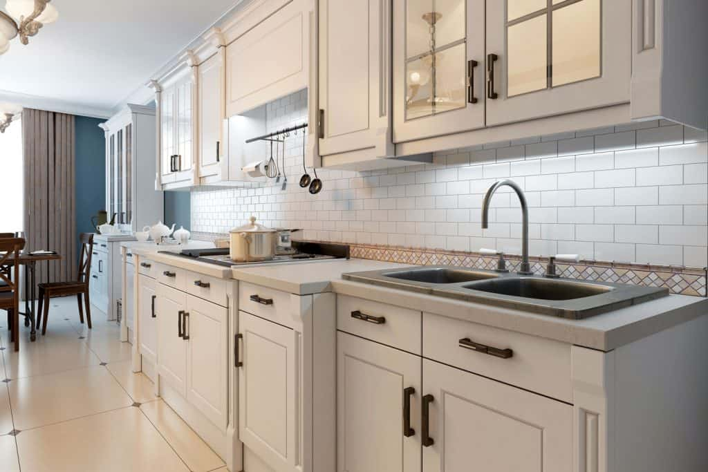 Open space kitchen and dining room inspired from a Mediterranean accent, What Color Cabinets Go With Cream Countertops?