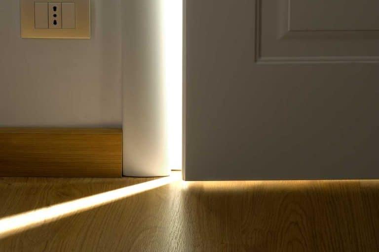 Opening white door with light behind, How To Stop Light From Coming Through Door