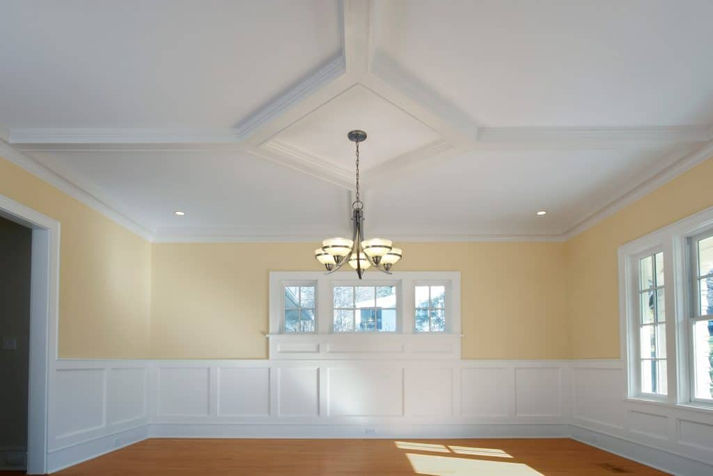 The dining room with chandelier in a newly built home.