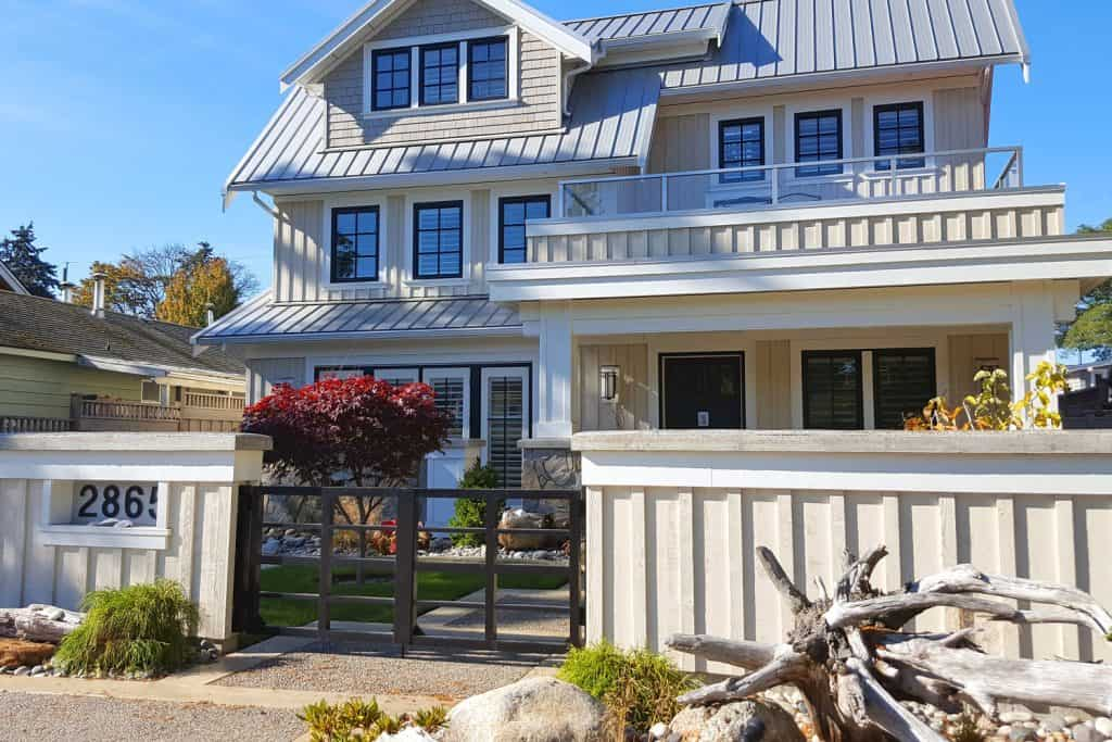 Three storey traditional American country home with board and batten sidings incorporated with elegant landscaping