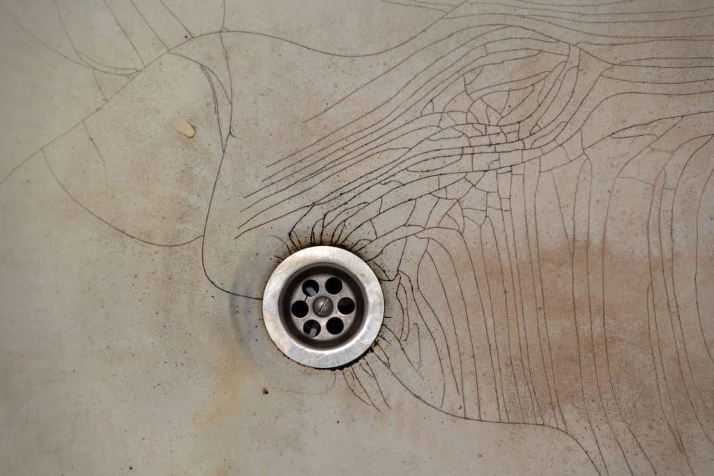 Up close photo of a cracked bathroom bathtub
