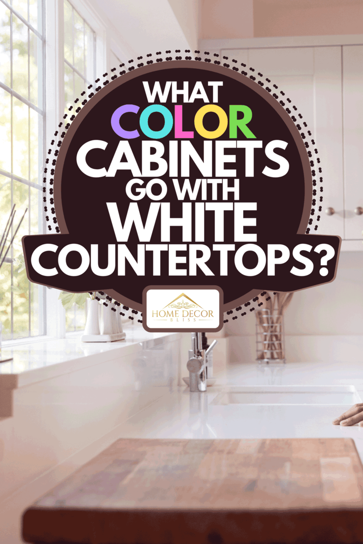 A white kitchen countertop with chrome faucet, What Color Cabinets Go With White Countertops?