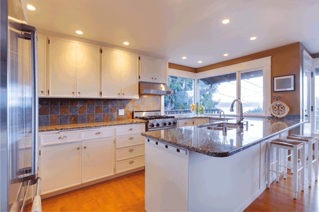 White large luxury modern kitchen with oak floor