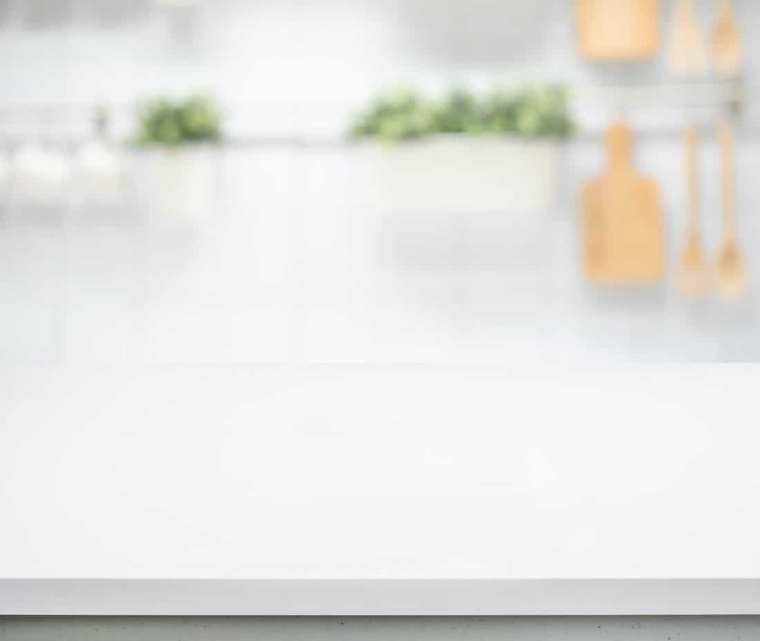 White wood table top on blur kitchen counter