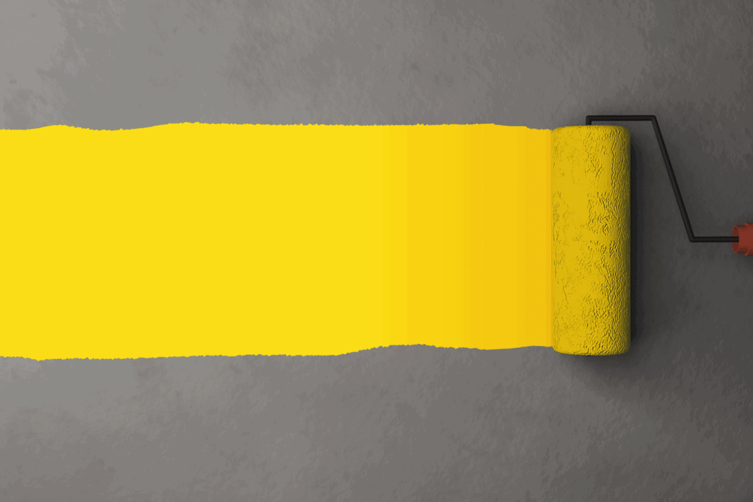 Yellow color painting by the roller brush and wall texture