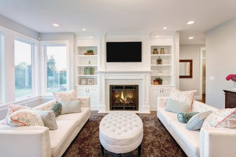 furnished living room in newly constructed home, How Much Space Between Electric Fireplace And TV?