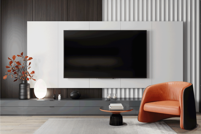modern black and white living room, small indoor plant, upholstered single seat. 15 Captivating Wall Decor Ideas For Above And Around TV