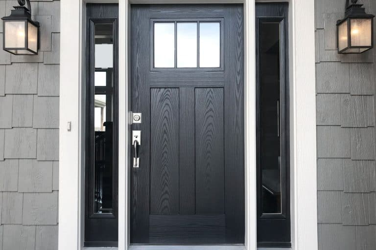 A black door with window panels on the sides, What Color To Paint Inside Of Front Door?