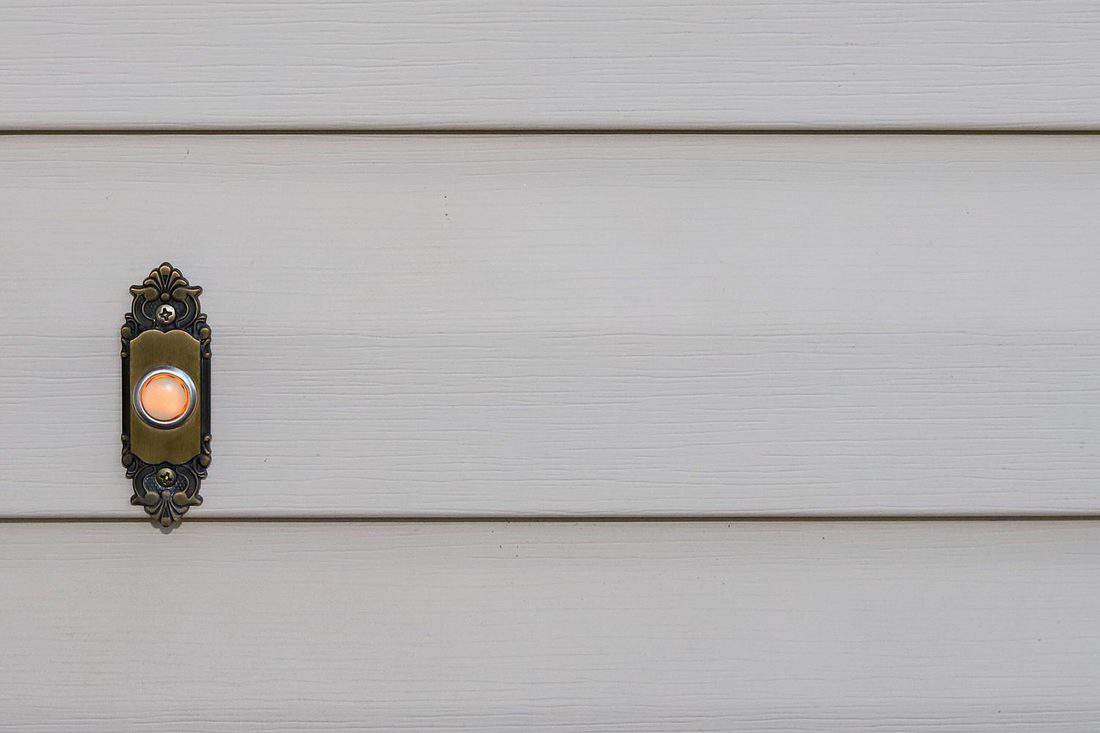 A close-up image of a doorbell on a residential home