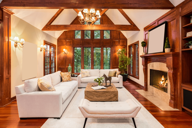 A living room with a rustic glow dazzled with mid century designed wall lamps and chandeliers expressing the earthiness of the room, 6 Best Paint Colors For A Room With High Ceilings