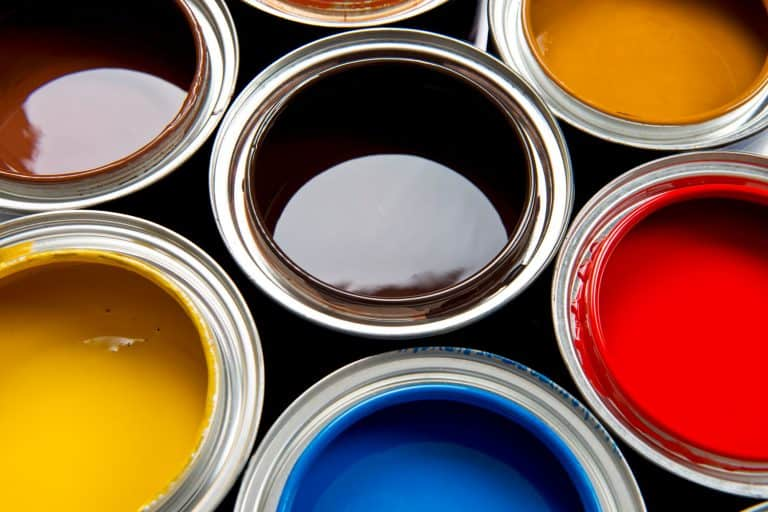 Buckets of paint with different colors, How Much Is A Gallon Of Benjamin Moore Paint? [A Cost Breakdown By Type Of Paint]