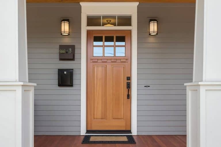 Covered porch and front door of beautiful new home, How Much Space Should You Have Between A Door And The Frame?
