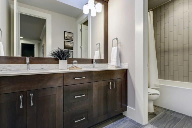 Double vanity cabinet topped with white counter, How To Fill The Gap Between Vanity Top And Wall