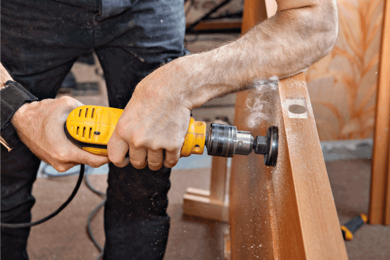 Installing doorknob, prepares door for knob and dead bolt, drilling bore holes through door using hole saw drill bit. How High Should Door Handles And Knobs Be