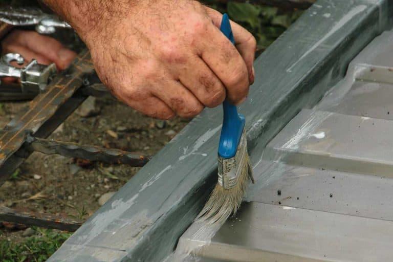 Man painting aluminum door, How To Paint An Aluminum Door In 6 Easy Steps