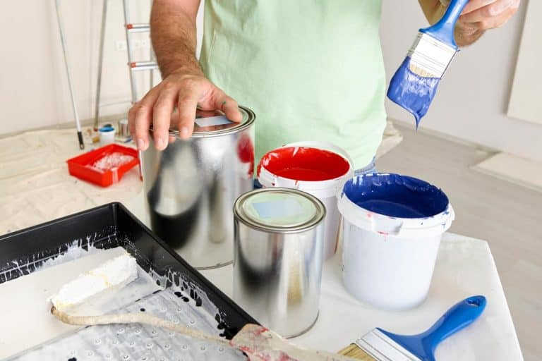 Man preparing paint, How To Paint With Benjamin Moore Advance