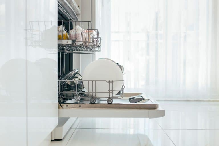 Open dishwasher with clean dishes, How Much Space Should Be Between Kitchen Cabinets For A Dishwasher?