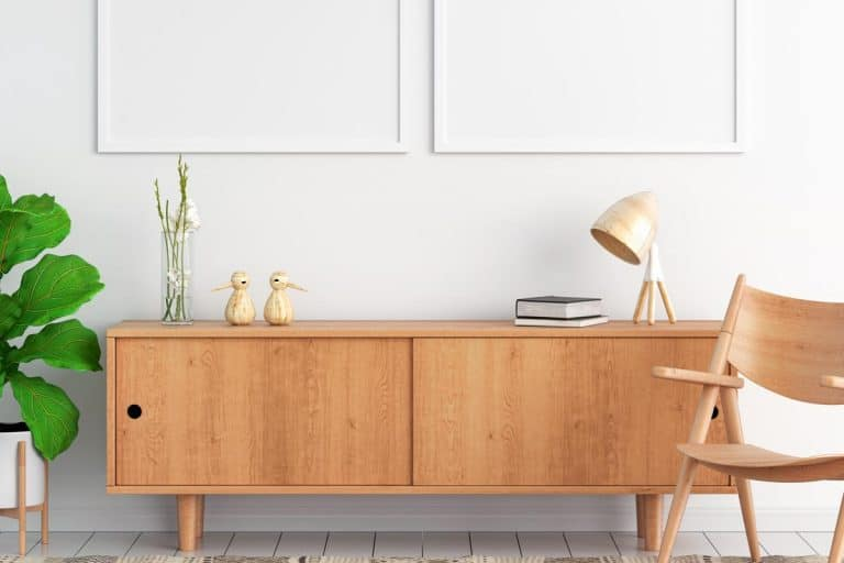 Sideboard and two blank photo frame on wall, How Much Does A Sideboard Weigh?