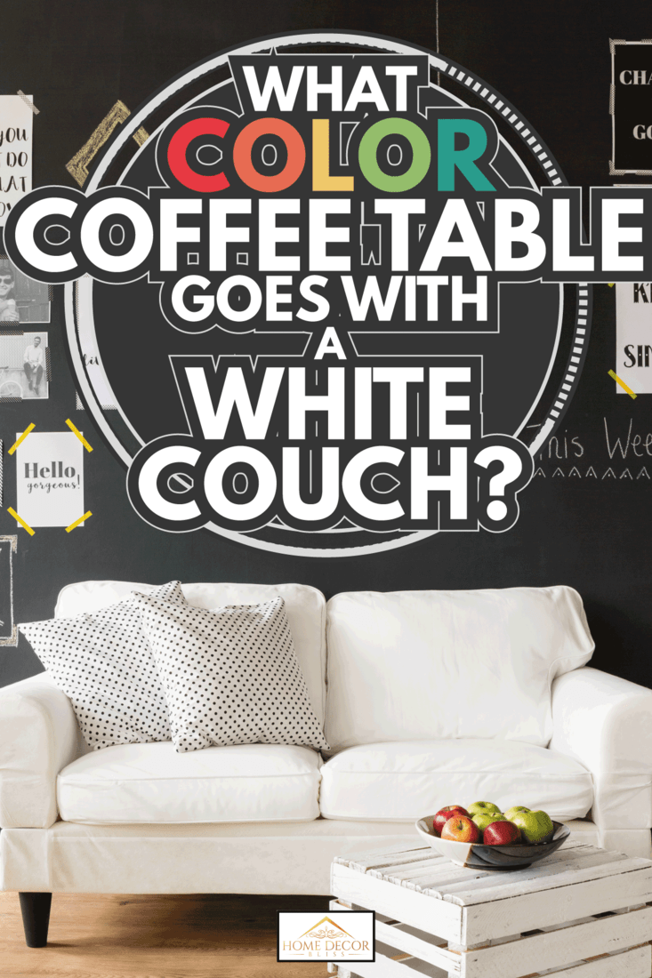 white couch in front of a blackboard wall with stationery. What Color Coffee Table Goes With A White Couch
